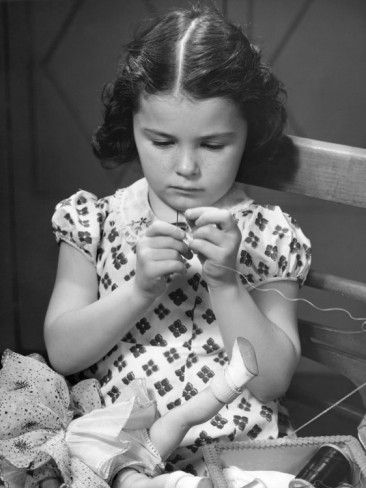 george-marks-girl-sewing-clothes-for-doll